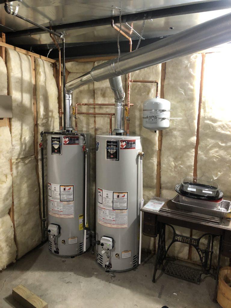 Dual water heater tanks